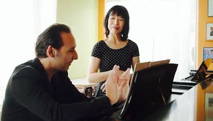 Film capture. Oscar winner 2015, Alexandre Desplat  preparing for recording with Gloria Cheng