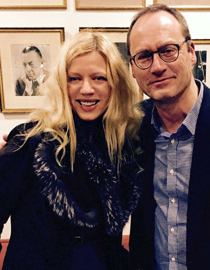 Valentina Lisitsa and Patrick Jovell in front of a portrait of Sergey Rachmaninoff at the Stockholm Concert House.