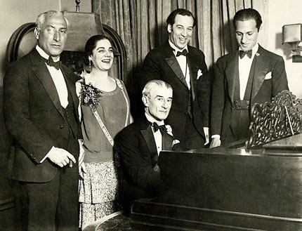 Ravel (at the piano) and Gershwin (to the right, apparently more interested in what Ravel is doing with his hands than smiling into the the camera) in New York 1928